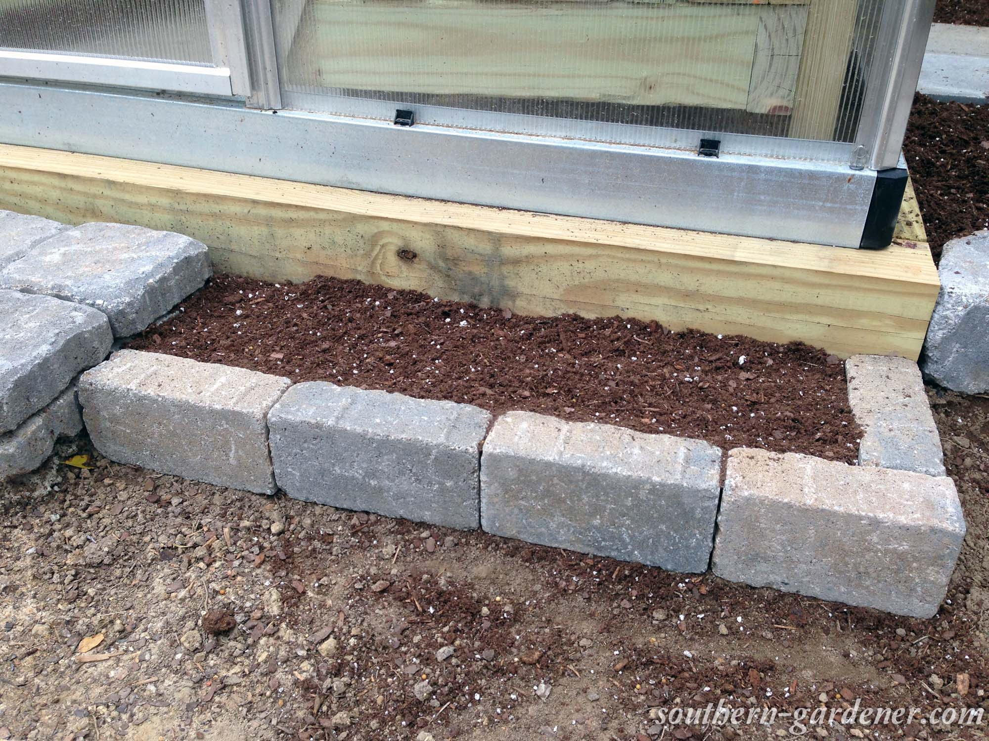 small flower beds with paver bricks