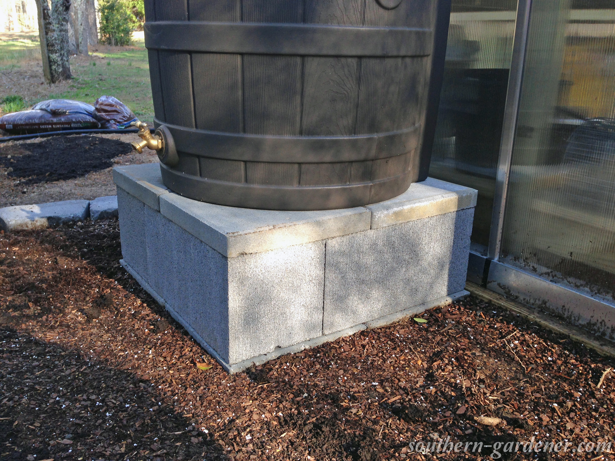 DIY cinder block rain barrel stand